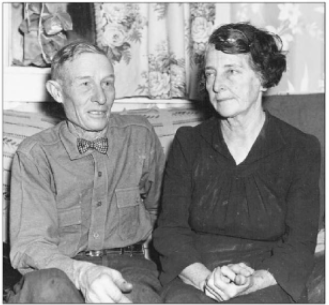 A black-and-white photo of an older couple, my Great-Great Uncle Laurence and Aunt Oda. The man is slightly gaunt and appears frail. The woman is a bit heavier, with a short bob held off her face with a bobby pin.